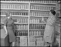 New Mexico. Mrs. Fidel Romero proudly exhibits her canned food.gif