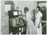 Ada Turner and Evelyn M. Driver pressure cooking peas.jpg