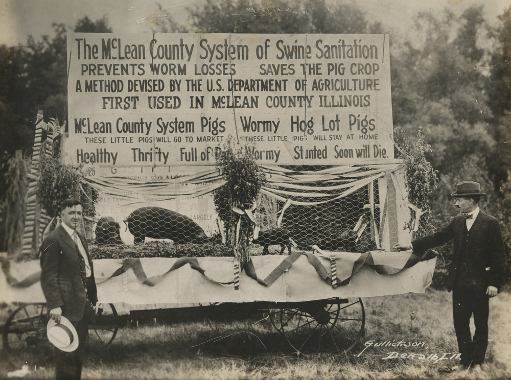 Thumbnail for the first (or only) page of McLean County System of Swine Sanitation float with Raffensperger and B.H. Ransom in Bloomington, Illinois.
