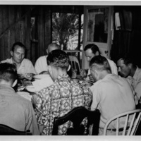 Photograph of Sanibel researchers eating dinner together