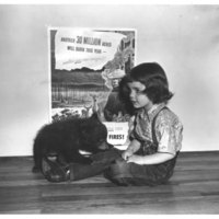 Judy Bell, 4 year old daughter of Ray Bell, New Mexico State Forester with her young friend, Smokey