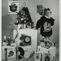 Elizabeth Forte poses here with some of the items produced by toy and novelty companies and carrying the Smokey name