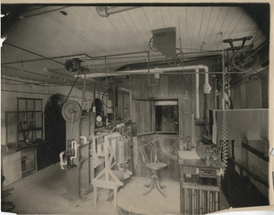 Thumbnail for the first (or only) page of Front view of respiration calorimeter. Air pump, water meter, observers table and entrance to the respiration chamber are shown in detail. The large balance at the left of the picture is used for weighing the caron-dioxid and water absorbers and the oxygen cylinder.  Judd Hall, Wesleyan University, Middletown, Connecticut.