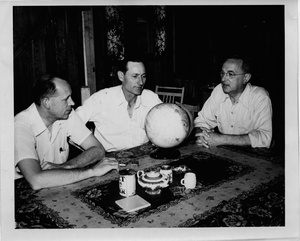 Thumbnail for the first (or only) page of Photograph of Edward F. Knipling and researchers seated at table with globe.