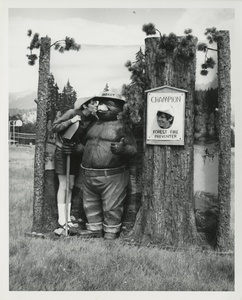 Thumbnail for the first (or only) page of People with Smokey Bear statue .