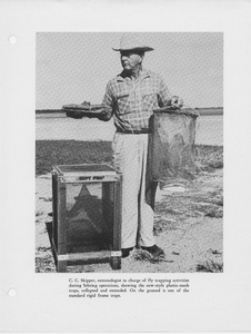 "Thumbnail for the first (or only) page of Photograph ""C. C. Skipper, Entomologist in Charge of Fly Trapping Activities During Sebring Operation, Showing the New-Style Plastic-Mesh Traps, Collapsed and Extended."