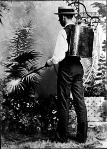 Thumbnail for the first (or only) page of The first American knapsack sprayer designed by Mr. Galloway, assisted by Mr. Fairchild, who is operating it in the old Bell Photographic Studio on the Avenue..
