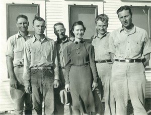 Thumbnail for the first (or only) page of Edward F. Knipling early employment. From left: Charles Hall, Billy Ellis, Parish, Miss Nash, Bushland, and Knipling..