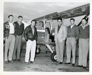 Thumbnail for the first (or only) page of First sterile fly drop, Florida Program, Orlando Airport. L-R: Mack, Mark Eure, Bill Cross, Tom Summergill, Graham, Jack Kalen or mba, - Britt.