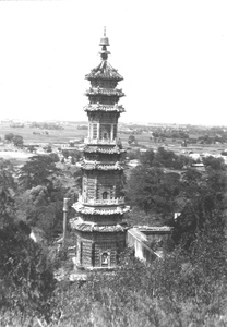 Thumbnail for the first (or only) page of Pagoda. Summer Palace. Peiping[, China]. Another view, but slightly different from the above [A beautiful bell topped pagoda among ruins on the north hills slope of the Summer Palace]. In the distan[t] background is a portion of a large agricultural valley. Photograph #45484..