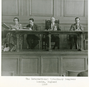 Thumbnail for the first (or only) page of Dr. H.W. Schoening (second from right) at The International Veterinary Congress, London, England.