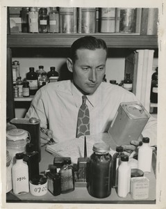 Thumbnail for the first (or only) page of Edward F. Knipling, U.S. Department of Agriculture entomologist, enters, under a code number, one of the preparations to be tested in the search for an effective louse killer for the use of our fighting forces.