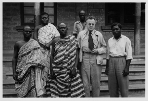 """Thumbnail for the first (or only) page of At Oyeko. Cacao farmers interviewed by Kellogg. At left of Kellogg (center) is the """"Chief Farmer"""" of Gold Coast - Kwame Poku; at extreme right is Saakodee who interpreted for Kellogg.."""