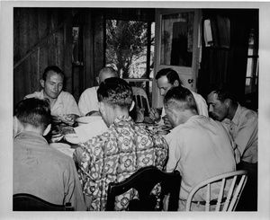 Thumbnail for the first (or only) page of Photograph of Sanibel researchers eating dinner together.