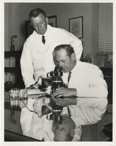 Thumbnail for the first (or only) page of Dr. Edward F. Knipling (seated) and Dr. Raymond C. Bushland in laboratory.