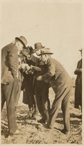 Thumbnail for the first (or only) page of A group of State and Federal officials seeing pink bollworm in the Trinity Bay section. Beginning at the left: Wilmon Newell, Plant Commissioner of Florida; Ernest E. Scholl, Entomologist of Texas; K.H. Townsend, Federal Horticultural Board; W.D. Hunter, Member of Board; Fred W. Davis, Comissioner of Texas..