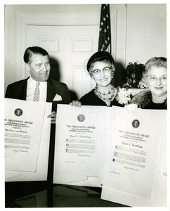 Thumbnail for the first (or only) page of These three were among the five who received President Eisenhower's Award for Distinguished Federal Civilian Service in a White House ceremony. From left to right: Wernher Von Braun, director of Development Operations for the Army Ballistic Missile Agency; Hazel K. Stieveling, director of the Institute of Home Economics of the U.S. Department of Agriculture; Mrs. Doyle L. Northrup, who accepted the award for her husband, Doyle L. Northrup, technical director of the Air Force Special Weapons Squadron..