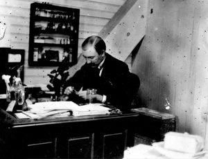 Thumbnail for the first (or only) page of Merton B. Waite in his laboratory in the attic of the old building, 1893, at a time when he was investigating the pollination of the pear..