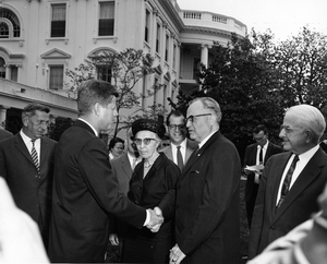 Thumbnail for the first (or only) page of Kellogg shaking hands with President John F. Kennedy.