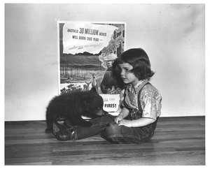 Thumbnail for the first (or only) page of Judy Bell, 4 year old daughter of Ray Bell, New Mexico State Forester with her young friend, Smokey .