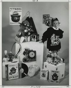 Thumbnail for the first (or only) page of Elizabeth Forte poses here with some of the items produced by toy and novelty companies and carrying the Smokey name .