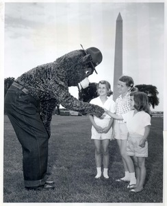 Thumbnail for the first (or only) page of Smokey Bear greets three youthful fans in Washington, D.C. .