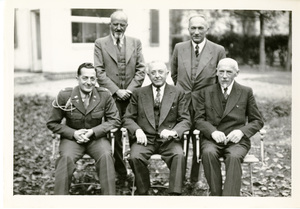 Thumbnail for the first (or only) page of Dr. H.W. Schoening (seated, center) in Stuttgart, Germany.