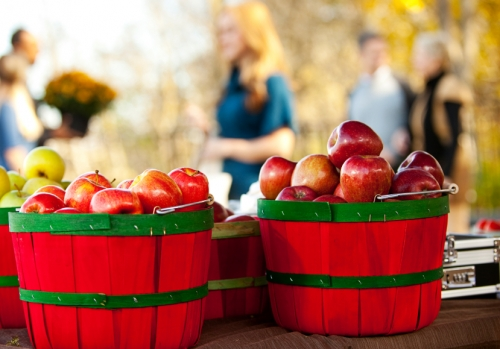 Two baskets of red apples at a Farmers Market. (iStock)