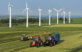 Farmers plowing fields near wind turbines (Copyright IStock).
