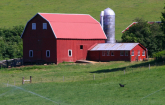 Red barn with silo (Copyright IStock).
