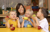 Children eating apples in the classroom. (Copyright ARS)