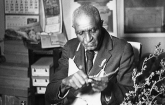 Portrait of George Washington Carver at work at Tuskegee University, Alabama