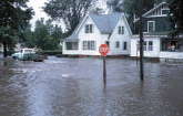 House and street intersection under flood waters