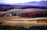 Farm scene with buildings, field crops, tractor (Copyright ARS)