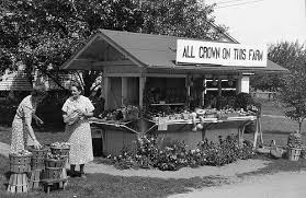 A roadside market operated by a local farmwoman in Hampshire County, Massachusetts in September 1940.