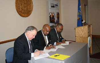 USDA Rural Development State Director signs the Subsidy Layering Review MOU agreement with WHEDA Executive Director and HUD Midwest Regional Administrator in Madison, Wisconsin