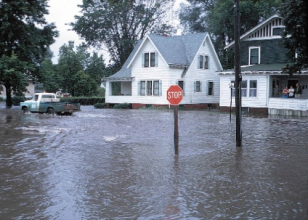 Flood waters surround a home