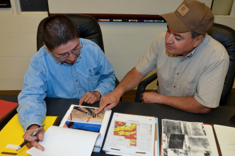 NRCS agent working with a local farmer to go over their contract.