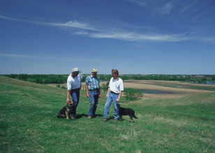 NRCS conservationists working with a landowner in eastern South Dakota.