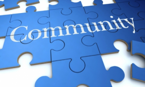 "Blue puzzle with text ""Community"" on it. (iStock)"