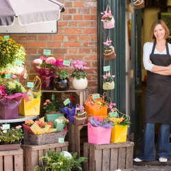 Women in front of a flower business (Copyright IStock)